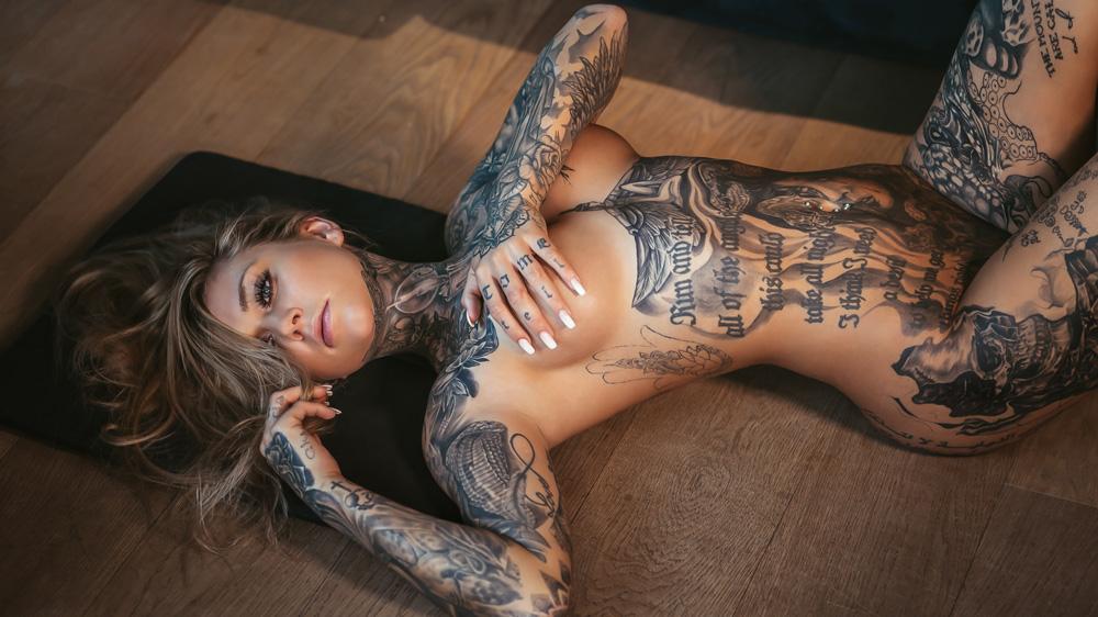 INKED boudoir model Dani on wood floor